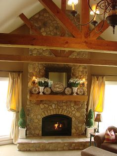 This is a lot like my fireplace.  Decorating the mantle throws me for a loop sometimes...love this look.