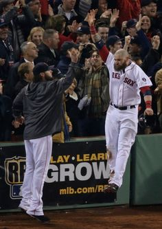 Gomes high fives salty after a great play Boston Red Sox and the 2013 World Series champs