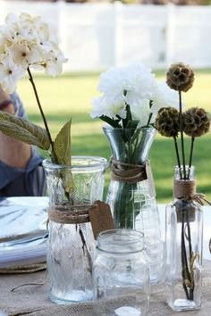 I like the idea of having different glass jars for the table flowers - so everything is not exactly matching, but in the same style. I also like the detail of the twine wrapped around the jar