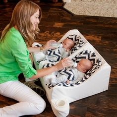 Tandem nursing or bottle feeding your twins, a twin nursing pillow will provide the comfort you need. Our Twin Nursing Pillow Guide is a must read and will help you choose the right one. Twin Girls, Twin Babies, Newborn Twins, Cribs For Twins, Twin Nursing Pillow, Twin Baby Rooms, Twin Baby Stuff, Twin Boy Nurseries, Room Baby