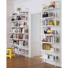 """This MIGHT be the solution.  Still $$ than Ikea - stairway 96"""" wall mounted bookcase in storage   CB2 (might be too narrow?)"""