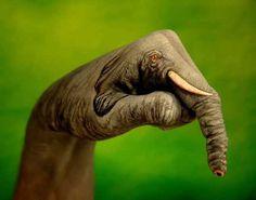 """Italian artist Guido Daniele who uses human hands as his canvas"""