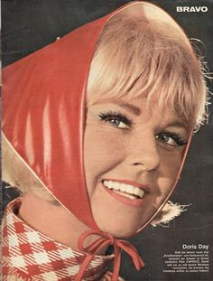 doris day wearing one of those triangular scarves that were so popular for awhile in the 60s...I had one in a leopard print!