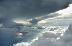 Photographer Rüdiger Nehmzow captured these photos of clouds four miles above the Earth through open airplane doors.