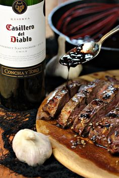 Vampire Steaks with Garlic Red Wine Reduction from cravingsofalunatic.com- This recipe uses flank steak marinated in garlic then grilled to perfection. It's topped with a red wine reduction made with garlic and onions. This is perfection for Halloween, or any time of the year. #sponsored (@CravingsLunatic)