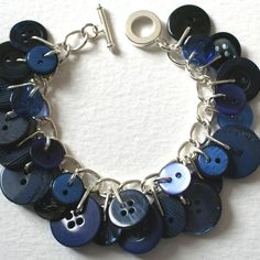 Lovely silver plated charm bracelet adorned with vintage and new buttons in navy blue shades. The charm bracelet measures approx inches or approx and is secured with a toggle and hoop clasp. I can adjust the bracelet making it bigger or smaller if needed. Button Art, Button Crafts, Beaded Jewelry, Jewelry Bracelets, Handmade Jewelry, Leather Bracelets, Leather Cuffs, Metal Jewelry, Diy Schmuck
