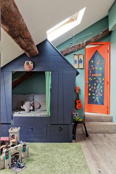 attic kid's bedroom with a built-in playhouse or reading nook