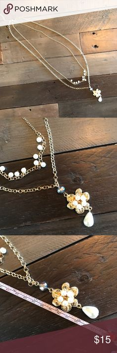 """💍 Long Pearl & Flower Multi Strand Necklace 2 strand long necklace with flower pendant and faux pearl accents. Gold. Excellent condition, Only worn three times! Approximately 38"""" length of longest chain. Bundle jewelry marked with a 💍 to save-$30 worth for $20 or $20 worth for $15. Van Heusen Jewelry Necklaces"""