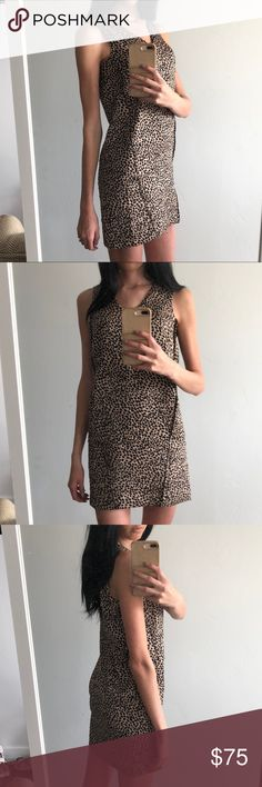 Anne Taylor Textured Cheetah Print Dress NWT Anne Taylor Textured Cheetah Print Dress NWT, brand new with tags, gorgeous animal print dress, very slimming and beautiful. Model is 5'11. Anne Taylor Dresses Midi