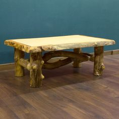 Aspen Log Coffee Table pictured with 2 curvy, criss crossing logs below.- USA made. Cabin decor