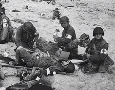 Medics Take Care Of The Wounded On Omaha Beach ... D-Day June 6, 1944