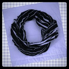 Striped Scarf NWOT Black and white. Stripes are reversed on other side. Lightweight. No tags. Thinking it's polyester. Accessories Scarves & Wraps