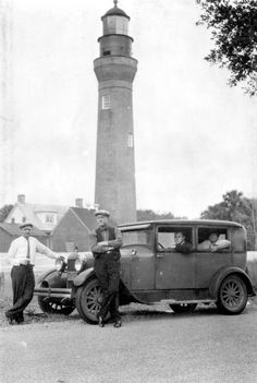Men stand in front of the Saint Johns River lighthouse (1939). | Florida Memory