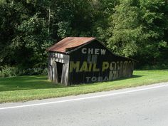 Leaning Mail Pouch Barn by jimmywayne, via Flickr