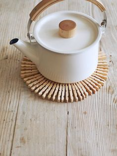 Does mom love tea? Whip up a Scandinavian-style table protector from–get this–wooden clothespins and floral wire.