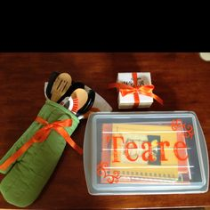 Wedding gift: oven mitt with dish towel and utensils; cake pan and lid personalized filled with cookbooks and cutting board and paring knife; costume made coasters. All pin inspired gifts!