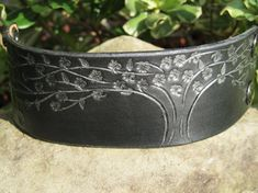 https://www.etsy.com/listing/160313418/hand-painted-tooled-leather-wide-cuff