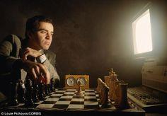 Chess player in black vs PC engine in white.