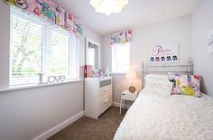 Girls pink and white bedroom.