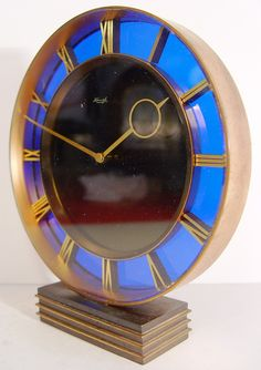 An Unusual 1930's Art Deco Kienzle Brass 8-Day Desk Table Clock With A Stained blue Glass