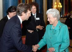 Eric Clapton, Brian May and Queen Elizabeth