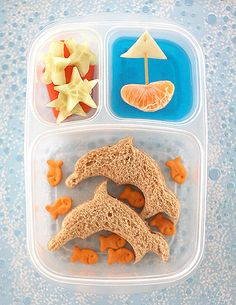 I know I'm not a kid anymore, but this still appeals to me for some reason! Ocean Lunch: Dolphin Sandwiches, Goldfish Crackers, Cucumber Starfish, Blue Jello Water with an Orange Slice Sailboat