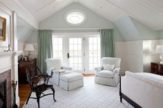 Beachy bedroom with white wainscoting, aqua walls and honey colored wood floors -- Patrick Ahearn Architect, www.patrickahearn.com