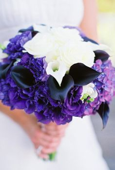 White, purple, and black bridal bouquet