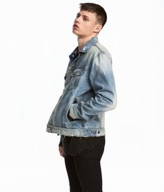 Check this out! Jacket in washed denim with heavily distressed details. Buttons at front and at cuffs, chest pockets with flap and button, and side pockets. Adjustable tab at sides of hem. - Visit hm.com to see more.