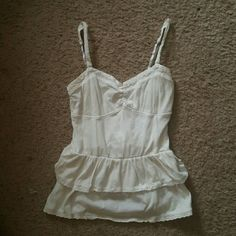 Tank top Summer tank top has lace on the ruffles and lave around the top and on the straps only worn a few times great condition nothing wrong just don't wear anymore. Very cute on with skirts shorts or pants. Aeropostale Tops Tank Tops
