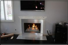 Aluminum or Stainless Steel fireplace surrounds. Stainless steel custom frames for fireplaces. Fireplace Frame, Fireplace Surrounds, Jeff Wall, Fireplace Makeovers, Hallways, Fireplaces, Custom Framing, Stainless Steel, Tv