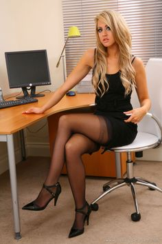Blonde beauty in minidress, stockings and heels