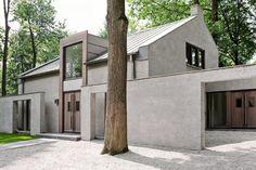 Karakteristiek huis in bosrijke omgeving