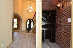 Entry way & Wine Cellar Room. Remodel by Sapphire Custom Homes#SapphireCustomHomes#CustomHomeBuilder#Remodel#Brickwall#Brickceiling#brickaccent