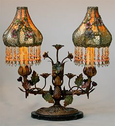 Wonderful pair of flowered tole candelabra lamp bases with original paint. The Sheik shades are dyed amber to green/light teal and covered in gold metallic lace and antique French chenille flower appliqués. Hand beaded fringe a Painted Lady House, Lamp, Beaded Lampshade, Chandelier Lamp, Beautiful Lamp, Lace Lamp, Victorian Lighting, Vintage Lamps, Victorian Lamps