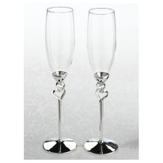 Standing tall, this pair of toasting glasses offers a lovely heart detail on the stem. The stem and base are silver plated and tarnish-resistant. Liquor Glasses, Flute Glasses, Champagne Glasses, Silver Wedding Favors, Personalized Wedding Favors, Wedding Toasting Glasses, Toasting Flutes, Flute Stand, Lillian Rose