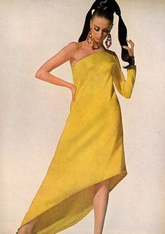Wilhelmina in a one-armed diagonal sweep of chrome yellow by Chester Weinberg, photo by Penn for Vogue, 1966