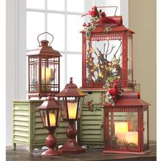 Festive lantern arrangement So pretty just about any where.  I am seeing this placed on the porch  farm table..