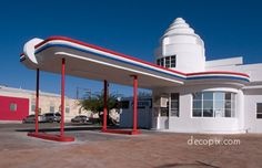 Art Deco: Streamline Moderne Tucson Gas Station with smooth geometric curved facade, parapets and eyebrows. Overhang with metal supports. Paneled windows followed curved walls. Roof with tiered tower.