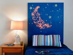 How to make a kid's headboard with built-in nightlights Holiday lights are used to create a built-in night-light in a little boy's bedroom. Glow-in-the-dark stars accompany the moonlight for some extra sparkle. Home Diy, Kids Headboard, Headboard Designs, Bedroom Design, Headboard Diy Easy, Diy Headboard With Lights, Bedroom Decor, Headboard With Lights, Diy Home Decor