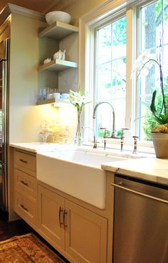 I love the sink, marble counter tops, and the large window - I think I would like doing the dishes if I had this kitchen