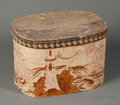 "Wallpaper-covered Bandbox, America, mid-19th century, oblong shaped box with printed ""SANDY-HOOK,"" with lighthouse and ship motifs in shades of red, pink, white, and brown, faded yellow ground, (wear to cover edge, fading), ht. 9 1/2, wd. 10 3/4, lg. 14 1/4 in."
