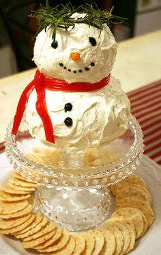 Snow Man Cheese Ball - 3 packages (8 ounces each) cream cheese, softened   4 cups shredded Cheddar cheese (16 ounces)   2 tablespoons basil pesto    1/4 teaspoon yellow mustard   2 drops red pepper sauce   1 container (4 ounces) whipped cream cheese, softened   Assorted crackers     1. Mix 3 packages cream cheese and the Cheddar cheese; divide into 3 equal parts. Combine 2 parts to equal two-thirds of mixture; mix in pesto. Mix mustard and pepper sauce into remaining one-third mixture.   2…