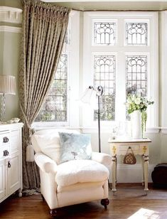 Sweet and Wonderful cottage sitting area, gorgeous leaded windows, tassel on the draperies.  Love it.