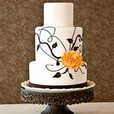 Black and white wedding cake.    I love the simplicity of this cake but I would make the flower blue