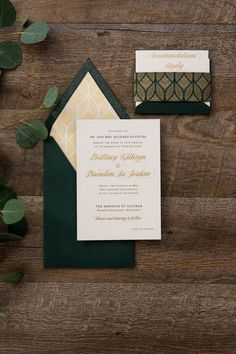 Custom green and gold matte thermography wedding invitation with a top, v-flap envelope.