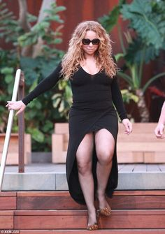 Proud of her body: Mariah Carey, 45, showcased her very shapely legs as she made her way down some steps in Malibu on Sundayy