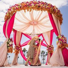 Weddings are a celebratory occasion which brings together two families. Confused whether to decorate your wedding mandap using florals or lights? We have curated a list with some awe-inspiring Wedding Mandap decor inspirations we know you'll love. Wedding Hall Decorations, Desi Wedding Decor, Wedding Mandap, Table Decorations, Wedding Ideas, Arch Wedding, Garden Wedding, Indian Wedding Stage, Wedding Dresses