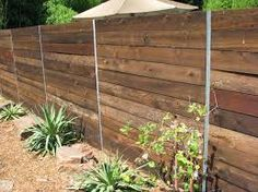 Steel & wood nice but fence too solid. PostMaster Steel Posts by Master Halco