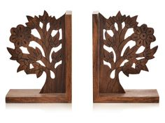 Wooden Engraved & Carved Tree Of Life Book End. This Tree of life bookend in classy brown has been beautifully engraved & crafted in the shape of tree depicting tree of life. Wooden carving in the shape of a tree has been done on the book end. This unique bookend has been handcrafted in sheesham wood and is an attractive addition to your home. This exquisite piece will elevate the beauty wherever it will be kept. #wood #bookholder #tree_bookholder